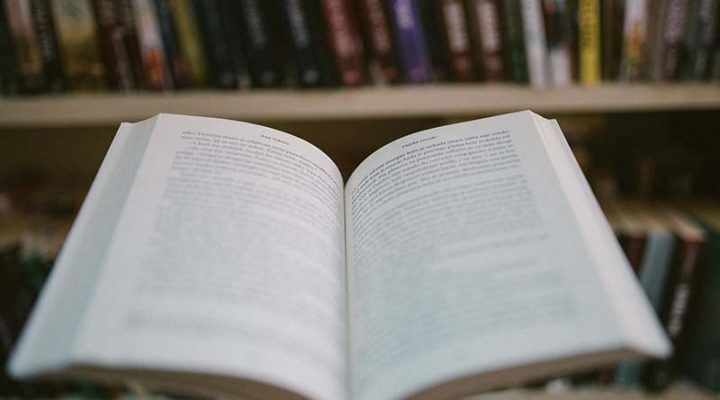 image of an open book in a library